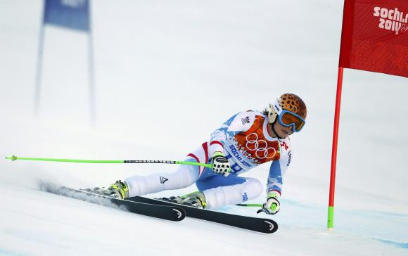 Austria's Fenninger clears a gate during the women's alpine skiing Super G competition at the 2014 Sochi Winter Olympics